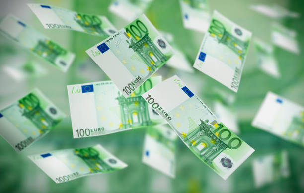Flying Banknotes 100 Euro Large number of flying 100 Euro Banknotes in the air euro symbol stock pictures, royalty-free photos & images
