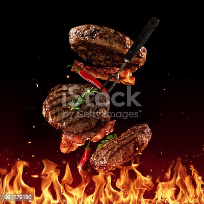 istock Flying beef minced hamburger pieces on black 961276190