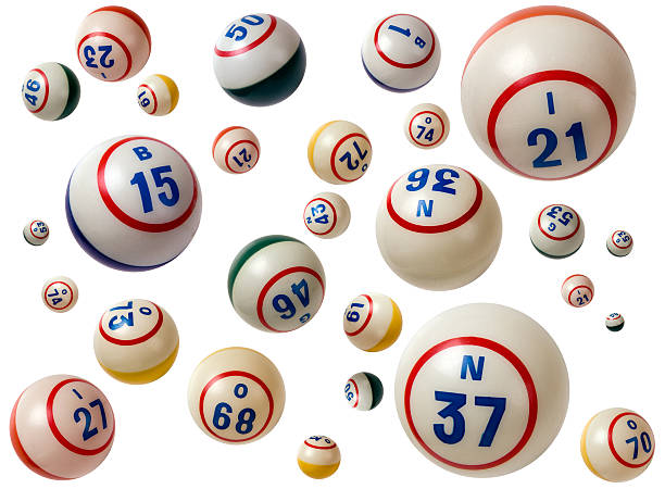 Flying Bingo balls with assorted numbers in white background stock photo