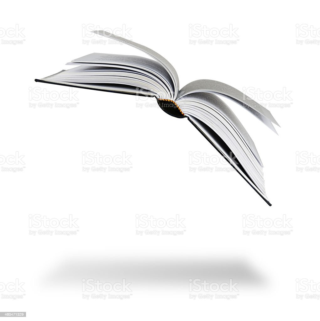 Flying book casting ground shadow on white background stock photo