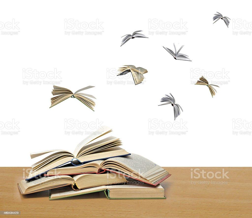 Flying books stock photo