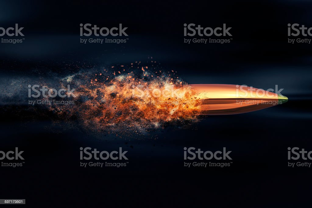 Flying bullet with dust trail stock photo