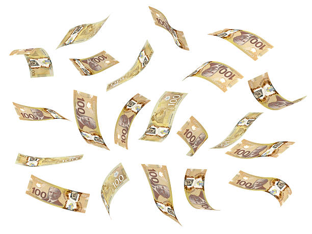 Flying Canadian dollars on a white background stock photo