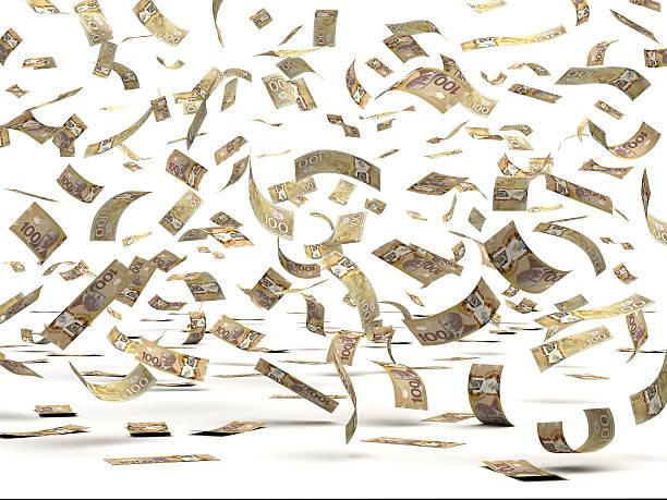 Flying Canadian Dollars stock photo