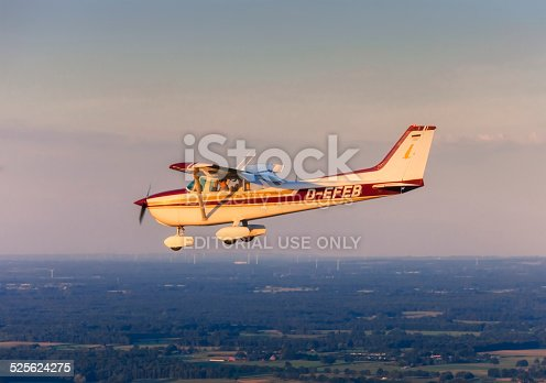Wesel, Germany - September, 9 2012: Flying Cessna 172 at sunset on September 9, 2012 over Wesel in the Lower Rhine Region of Germany. The Cessna 172 is the most successful aircraft in history. It is a four seat, single engine and high wing aircraft.