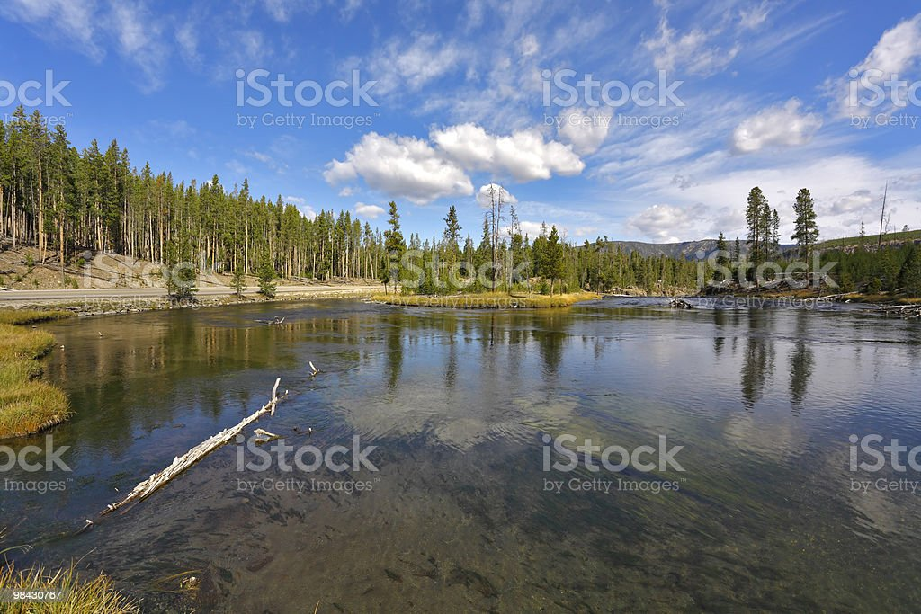 Flying clouds over river in the USA royalty-free stock photo