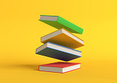 istock Flying color books on pastel yellow background 1304915362