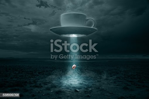 High resolution composite image of a UFO reimagined as a steaming cup of coffee, abducting a lone coffee bean in the New Mexico desert. Bean is being lifted by a tractor beam being projected from an emitter on the bottom of the saucer. There is text space to the left and right. No coffee beans were harmed in the making of this image, although at least one was probed in a rather delicate area.