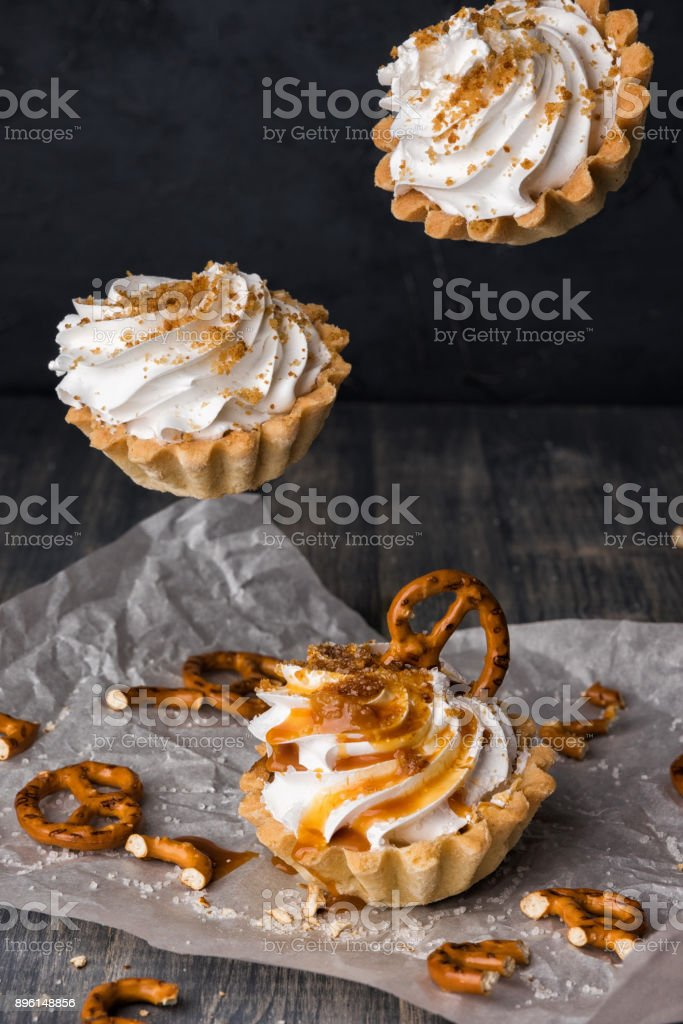 Flying cupcake with salted caramel and pretzels. stock photo