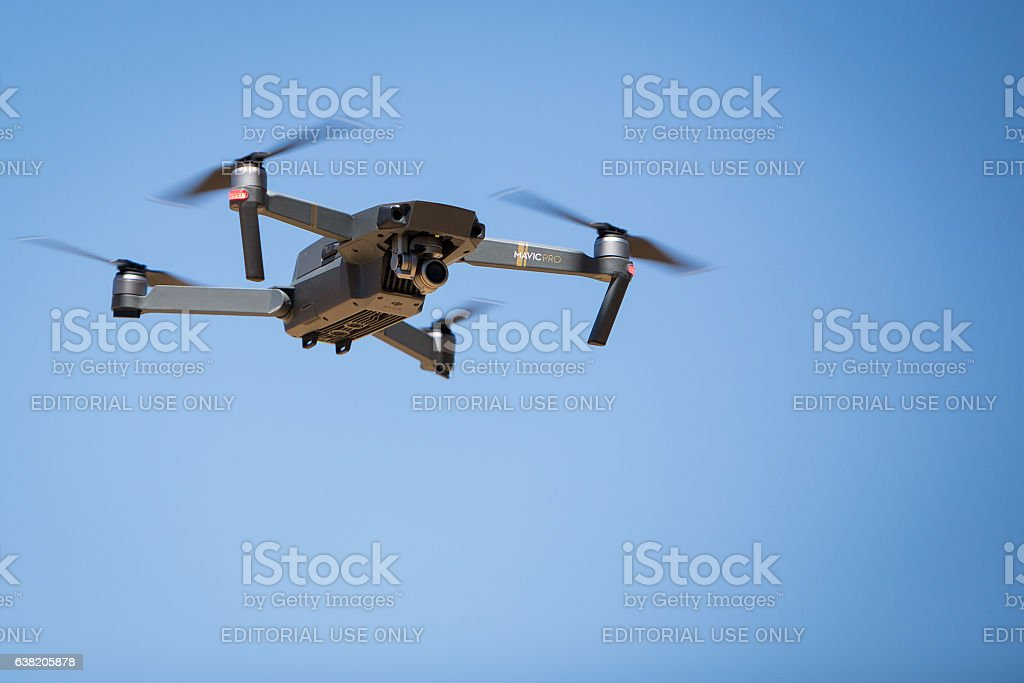 Flying Dji Mavic Pro Compact Drone Stock Photo More Pictures Of