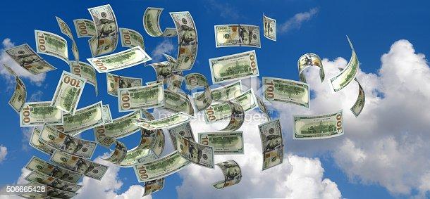 istock Flying Dollars 506665428