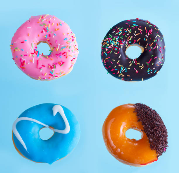 flying doughnuts on blue stock photo
