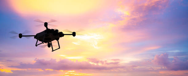 flying drone in sky - drones stock pictures, royalty-free photos & images