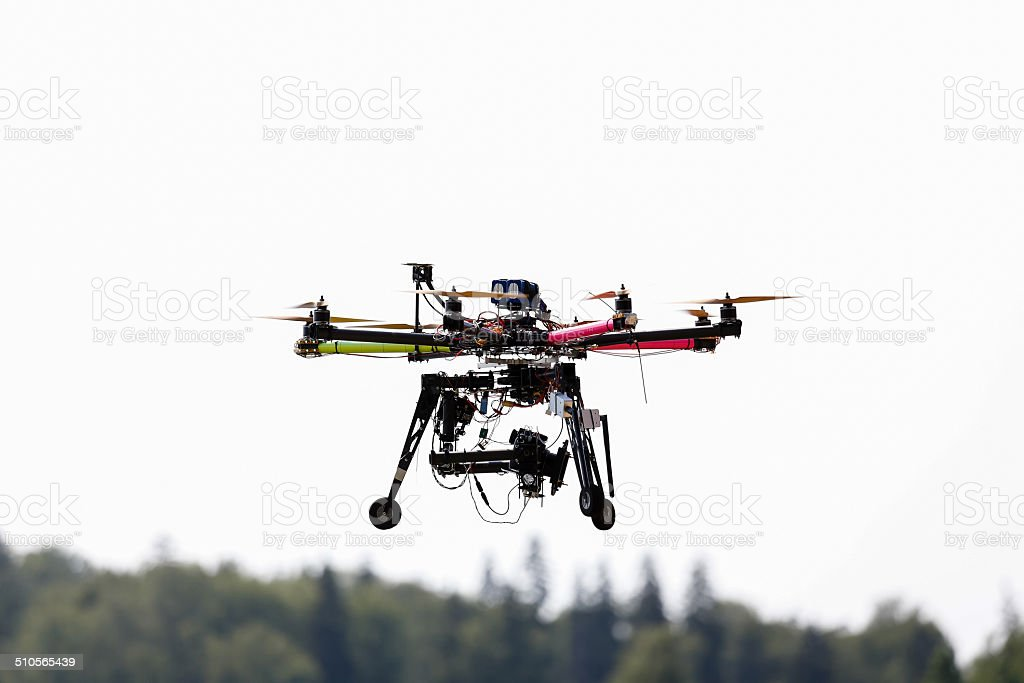 Flying drone in the sky stock photo
