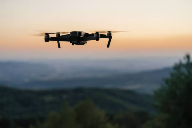 flying drone - drones stock photos and pictures