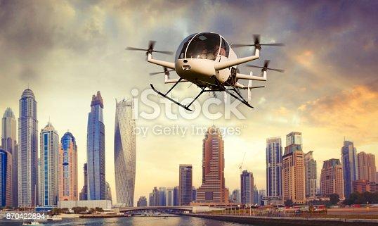 istock Flying drone transporting people in Dubai 870422894