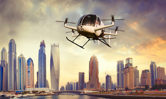 Flying futuristic drone transporting people in Dubai