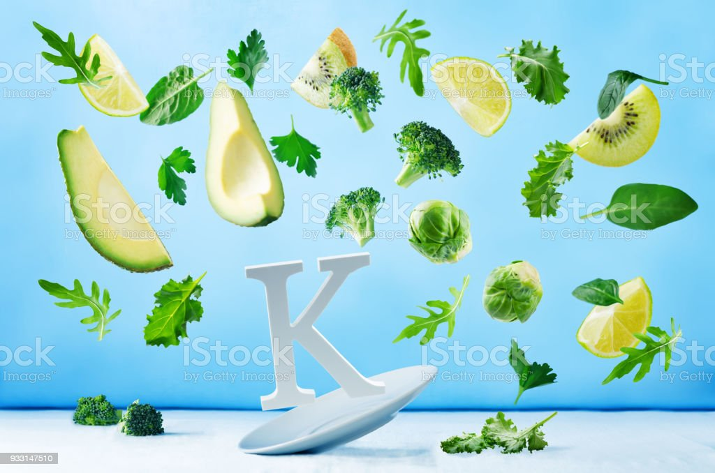 Flying foods rich in vitamin k. Green vegetables stock photo