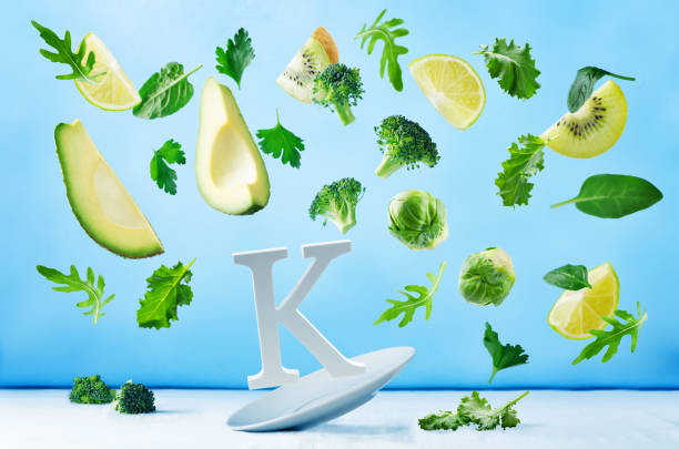 flying foods rich in vitamin k. green vegetables - буква k стоковые фото и изображения