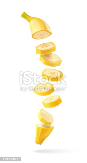Flying fresh ripe banana slices isolated on white background
