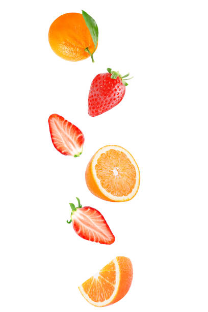Flying fresh strawberry and orange fruits isolated on white background with clipping path stock photo