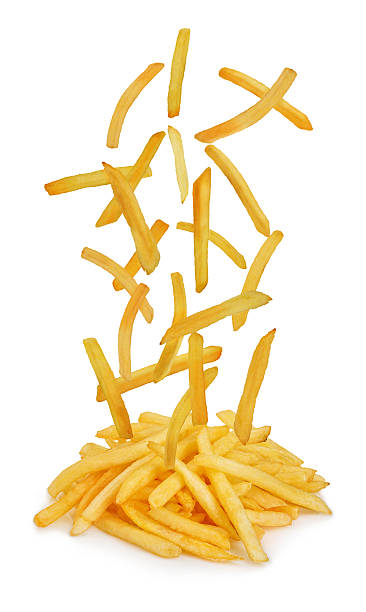 Flying fried potatoes isolated on white background. French fries. stock photo