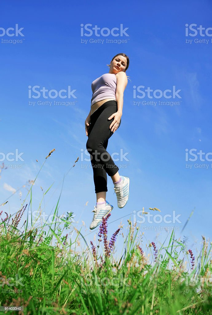 Flying girl on meadow royalty-free stock photo