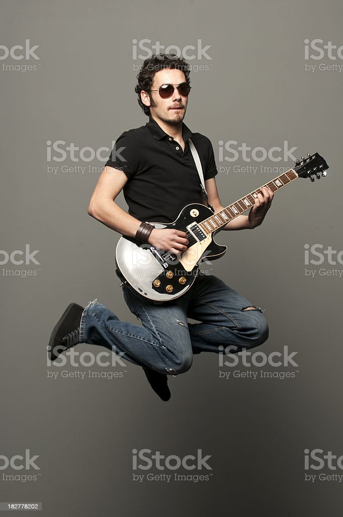 Flying Guitarist: Rock Out! royalty-free stock photo