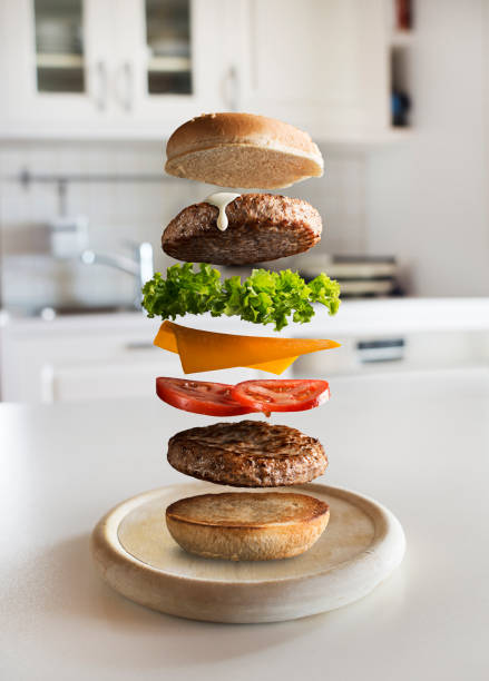Flying hamburger with flying ingredients stock photo