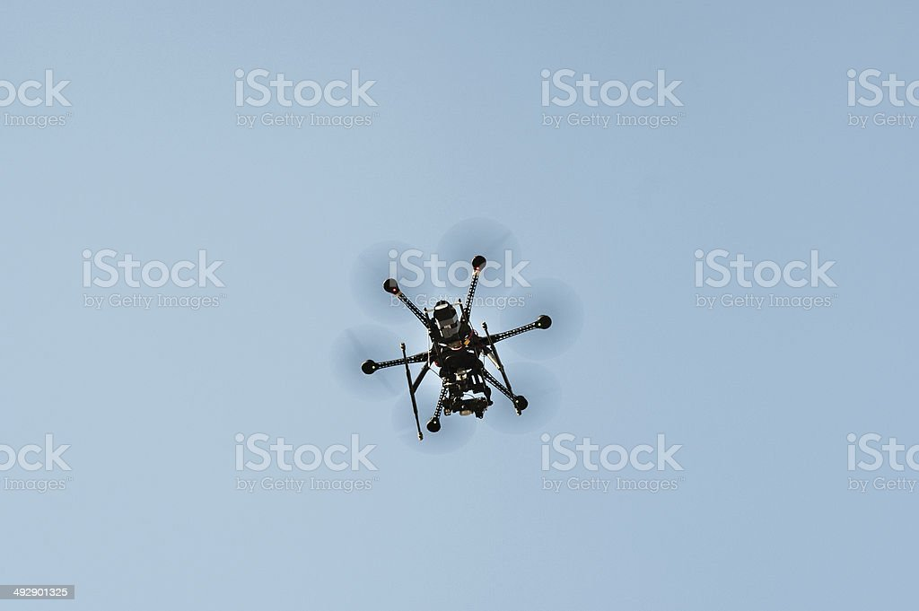 Flying hexacopter drone stock photo