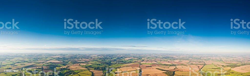 Flying high blue sky farmland vista royalty-free stock photo