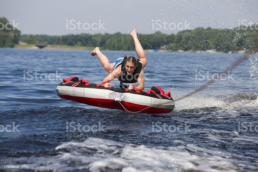 Flying high intertubing. stock photo