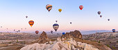 istock Flying hot air balloons and rock landscape at sunrise time in Goreme, Cappadocia, Turkey 1195521093