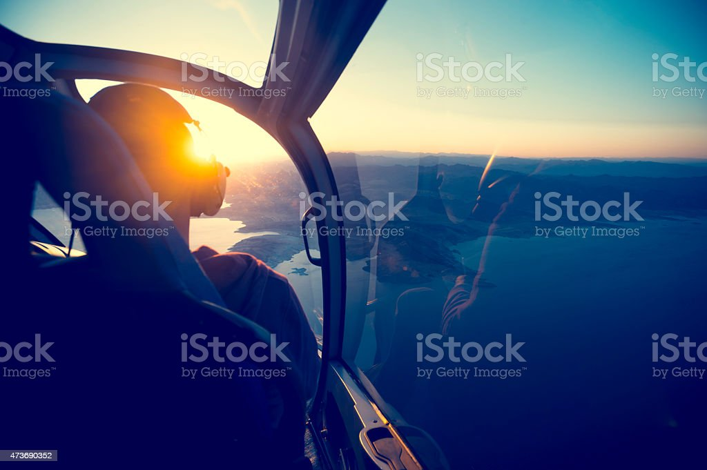 Flying in a helicopter over lake mead in Arizona. stock photo