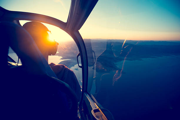 flying in a helicopter over lake mead in arizona. - pilot stock photos and pictures