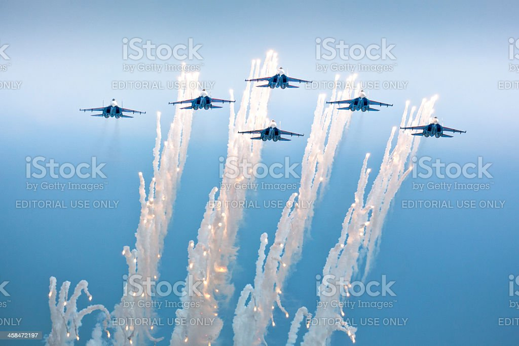 Flying in formation Russian Knights aerobatic team releasing fireworks royalty-free stock photo