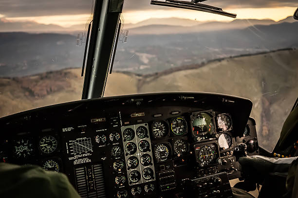 flying in sunset over mountains in cockpit - cyclic stock pictures, royalty-free photos & images