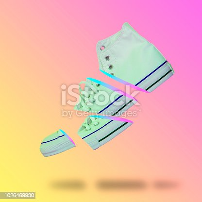 1014178170istockphoto Flying in the air slices of white sneaker. 1026469930
