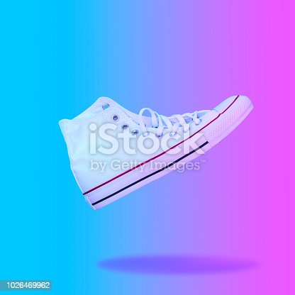1014178170istockphoto Flying in the air white sneaker. 1026469962
