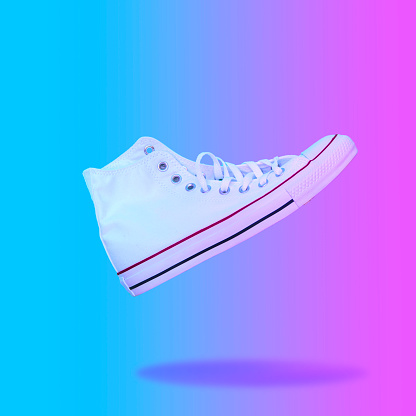 istock Flying in the air white sneaker. 1026469962