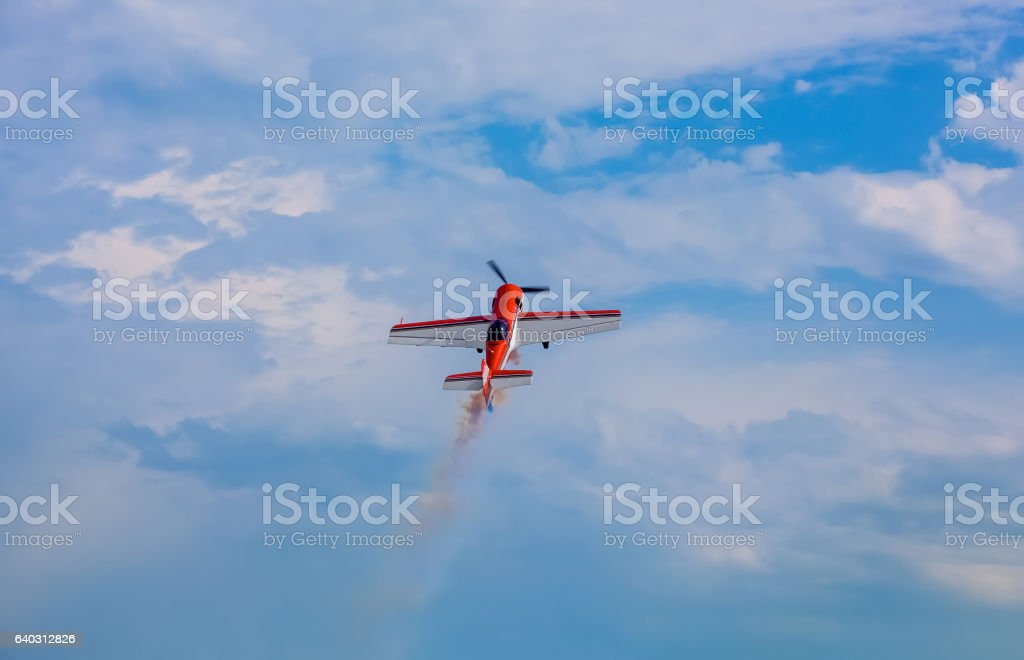 Flying in the sky on background of clouds the plane. stock photo