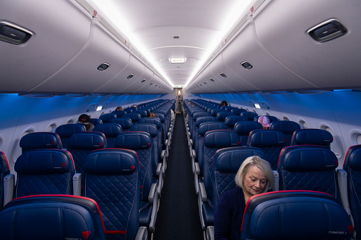 Atlanta, USA - March 21, 2020: Delta Airlines flight 0958, from Atlanta to Melbourne, FL, prepares to depart with only a handful of passengers on board due to the spreading coronavirus pandemic.