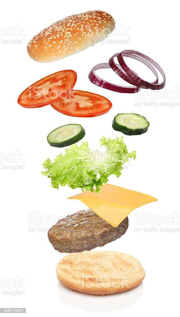 Flying ingredients of hamburger isolated on white stock photo