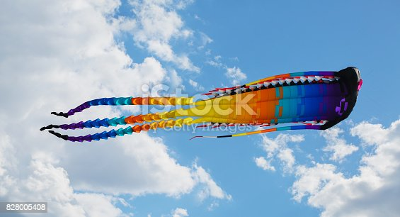 Big Chinese dragon kite in the blue sky and clouds
