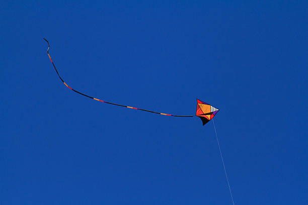 Flying Kite with Tail High stock photo