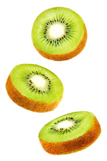 flying kiwi slices isolated - kiwi imagens e fotografias de stock