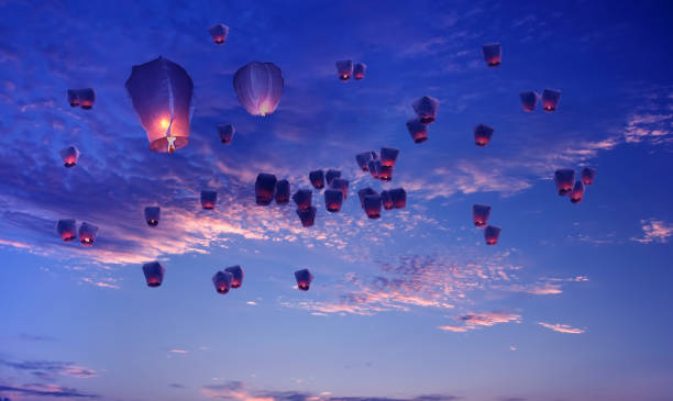 Flying lanterns in the sky stock photo