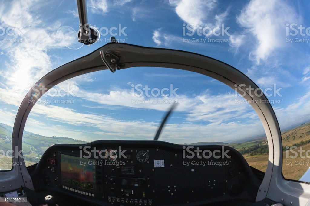 Flying Light Aircraft Cockpit Pilot View Stock Photo - Download Image Now