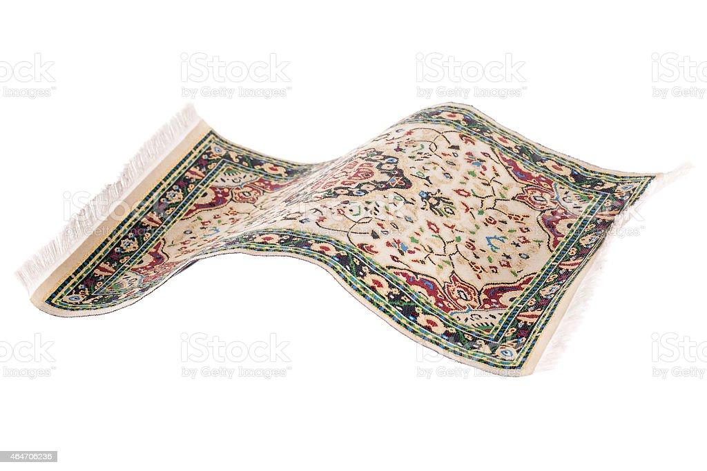 Flying magic carpet isolated stock photo