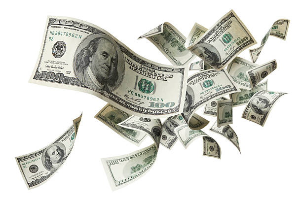 flying money lots of banknotes are flying against white background mid air stock pictures, royalty-free photos & images